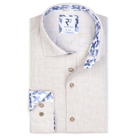 Beige linen shirt.