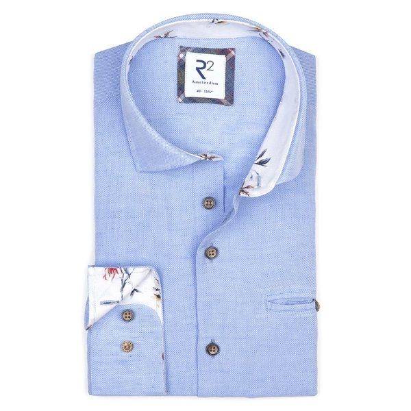 Lichtblauw linnen/katoenen overhemd met borstzak.
