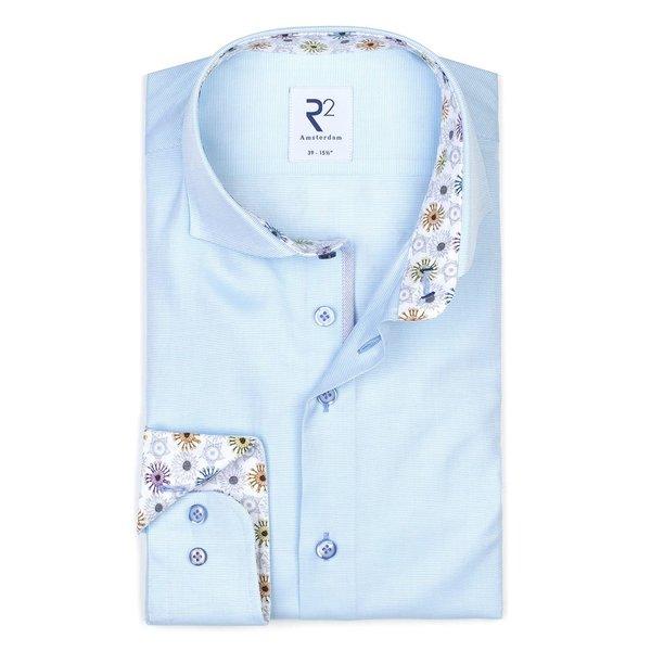 Light blue oxford cotton shirt.