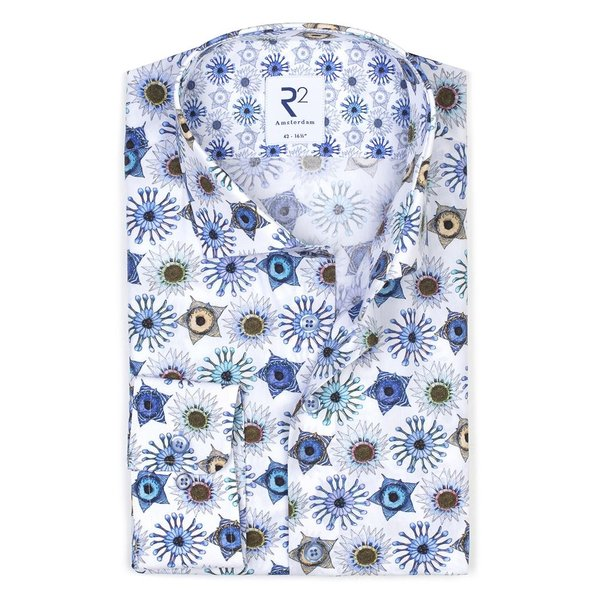 White cotton shirt with blue graphic print.