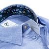 Light blue cotton shirt.