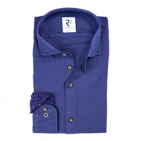 Navy garment dyed katoenen overhemd.