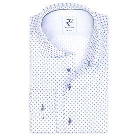 Baumwollhemd mit weißen Punkten bedruckt.