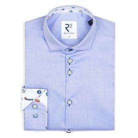 Kids light blue cotton shirt.