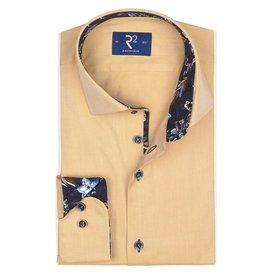 Geel effen katoenen overhemd.