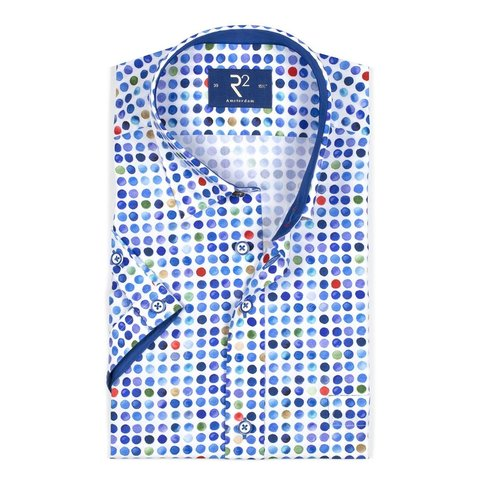 Short sleeved white polka dot print cotton shirt.