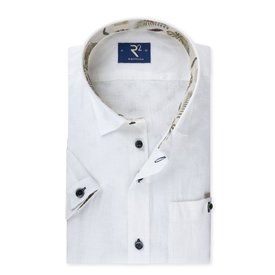 White linen shirt in short sleeves with tropical contrast.