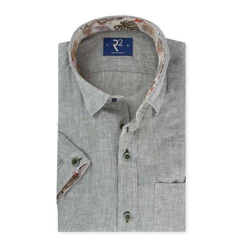 Short sleeved grey linen shirt.