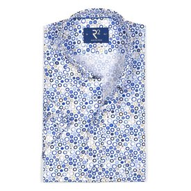 White short sleeves shirt with blue dots.