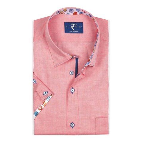 Short sleeves orange cotton shirt.