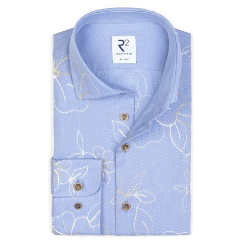Light blue embroidered cotton shirt.