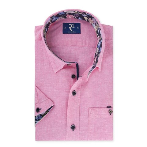 Short sleeved pink linen shirt.