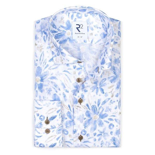 R2 Blaues Leinenhemd mit Blumendruck.