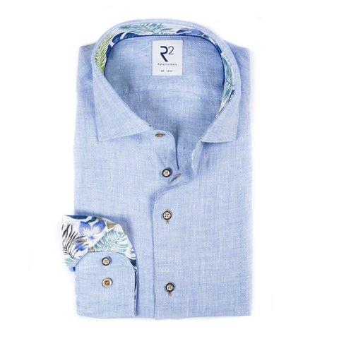 Lichtblauw herringbone linnen overhemd.
