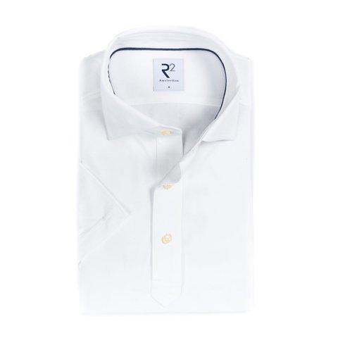 Wit piqué katoenen overhemd.