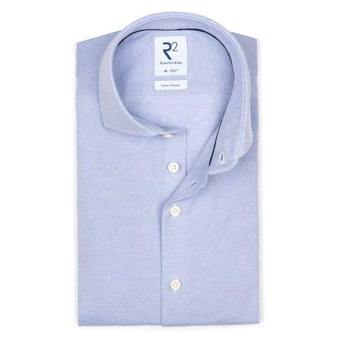 Hellblaues Piquet-Strickhemd aus Baumwolle.