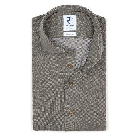 Dunkelgrünes Piquet-Strickhemd aus Baumwolle.