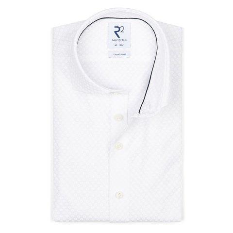 Weißes Piquet-Strickhemd aus Baumwolle.