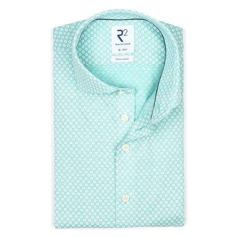 Hellgrünes Piquet-Strickhemd aus Baumwolle.