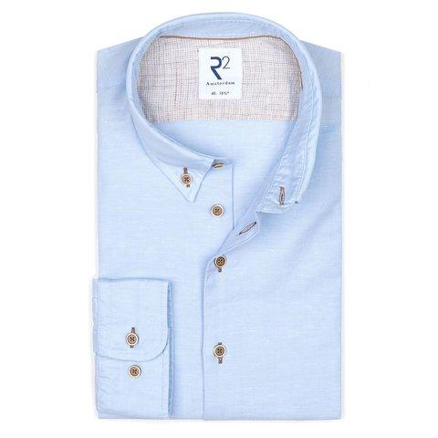 Lichtblauw linnen/katoenen overhemd.