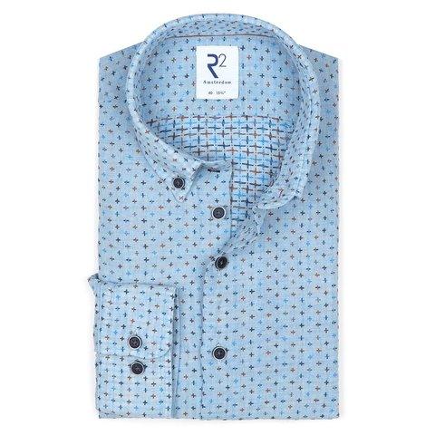 Blauw geborduurde linnen overhemd.