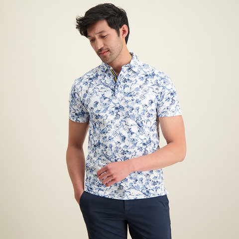 White flower print polo shirt.