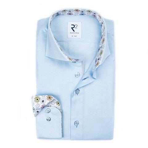 Lichtblauw oxford katoenen overhemd.