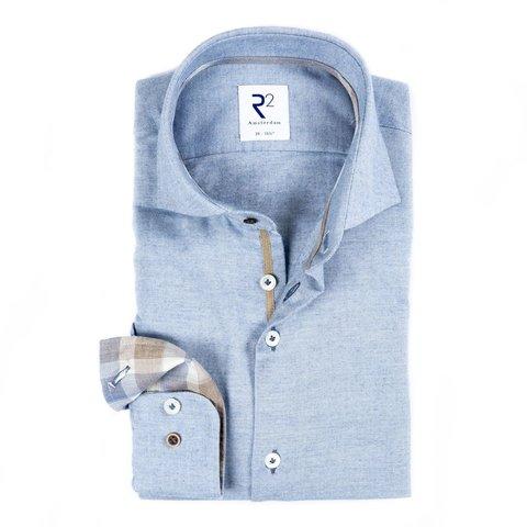 Lichtblauw flanel katoenen overhemd.