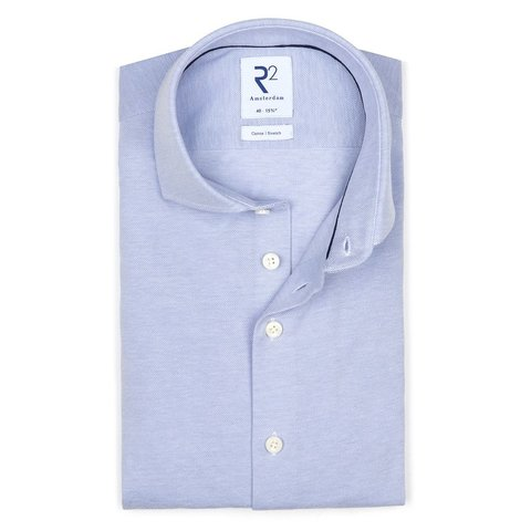 Lichtblauw piqué knitted katoenen overhemd.