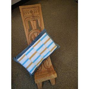 Pillow of handwoven Kente fabric and denim