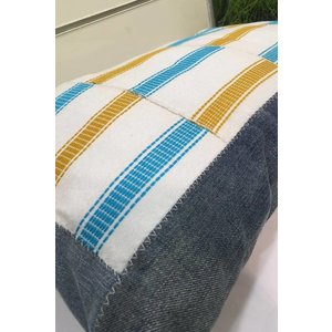 Pillow of handwoven Kente fabric and denim