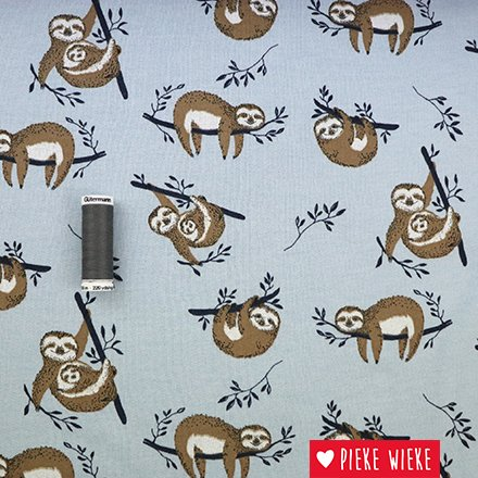 Sweater fabric with sloth print on a lightblue background