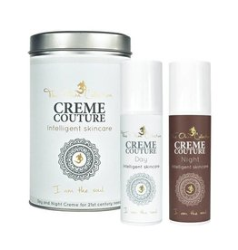 The Ohm Collection Creme Couture Day & Night cream in tin