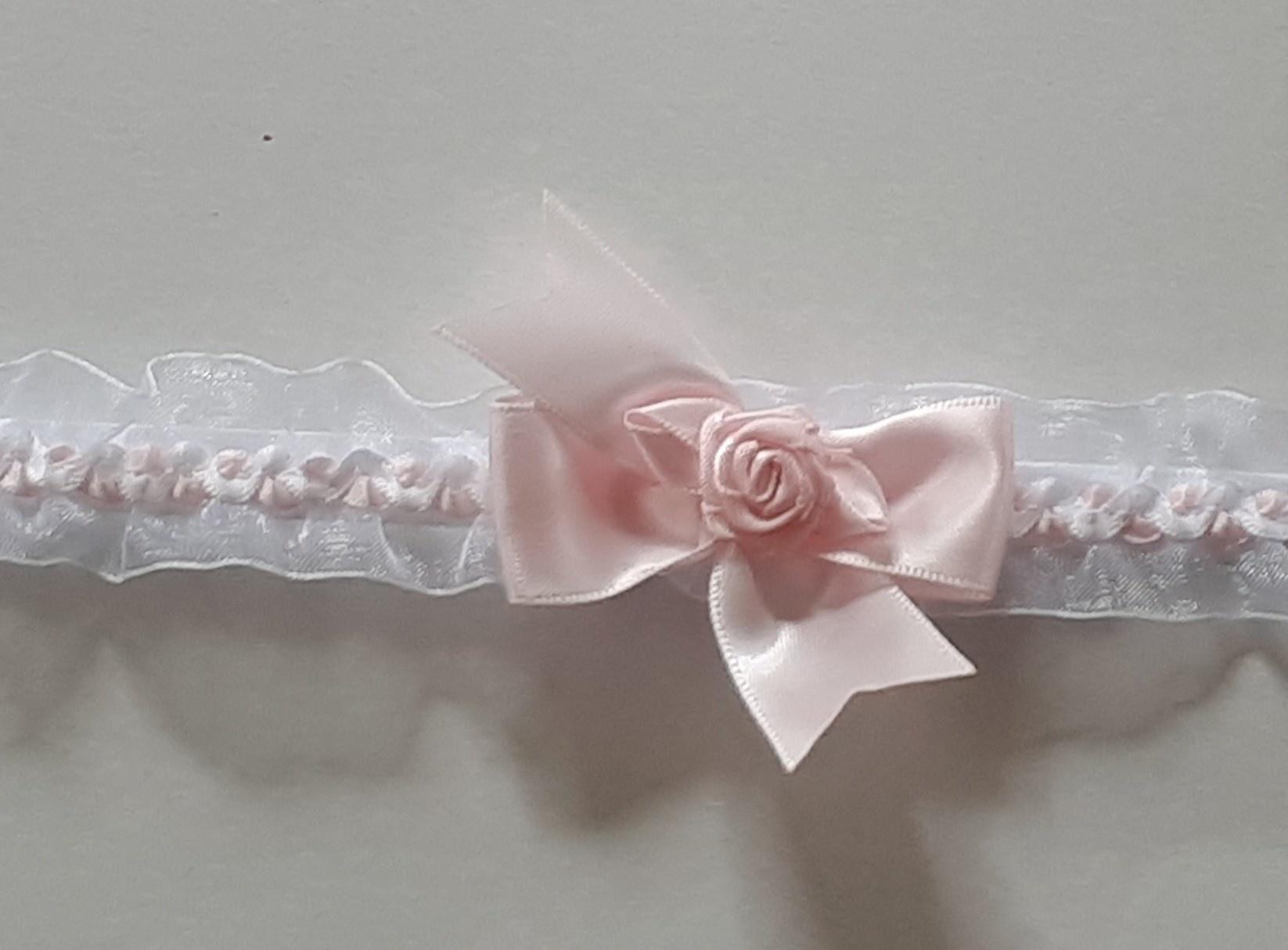 Organza hoofdbandje wit met roze strik en roosje