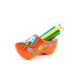 Oranje klompenpuntenslijper met kleurpotloden