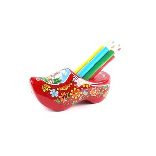 Red clog with sharpener and pencils