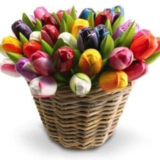 Wooden tulips in a wicker basket in mixed colors