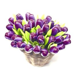Deep purple wooden tulips in a wicker basket