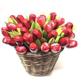 Wooden tulips in a wicker basket in mixed colors of red