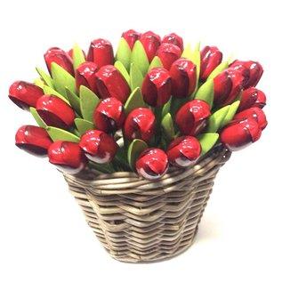 Red wooden tulips in a wicker basket