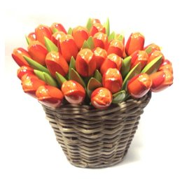 Orange wooden tulips in a wicker basket