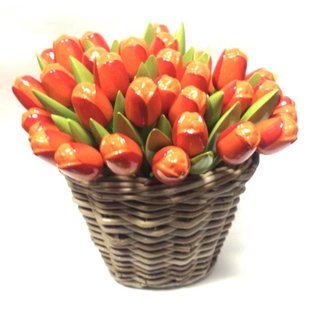 Orange wooden tulips in a wicker basket