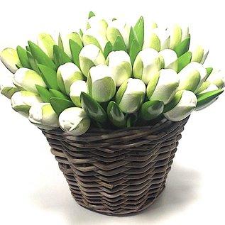 white wooden tulips in a wicker basket