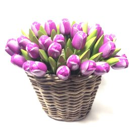 Purple wooden tulips in a wicker basket