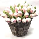 white - rose wooden tulips in a wicker basket