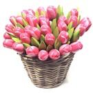 rose - white wooden tulips in a wicker basket