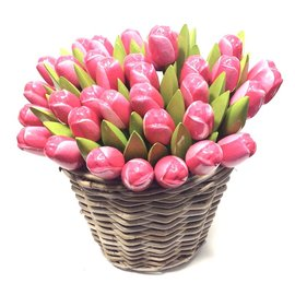 Pink - white wooden tulips in a wicker basket