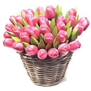 pink - white wooden tulips in a wicker basket