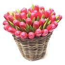 Rose wooden tulips in a wicker basket