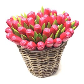 Pink wooden tulips in a wicker basket
